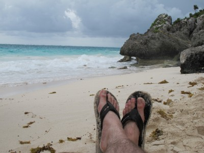 Feet on the Beech at Tulum Ruins in Mexico