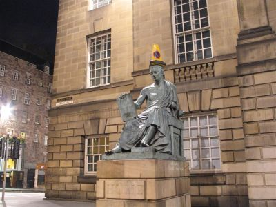 Statue with street cone in Edinburgh
